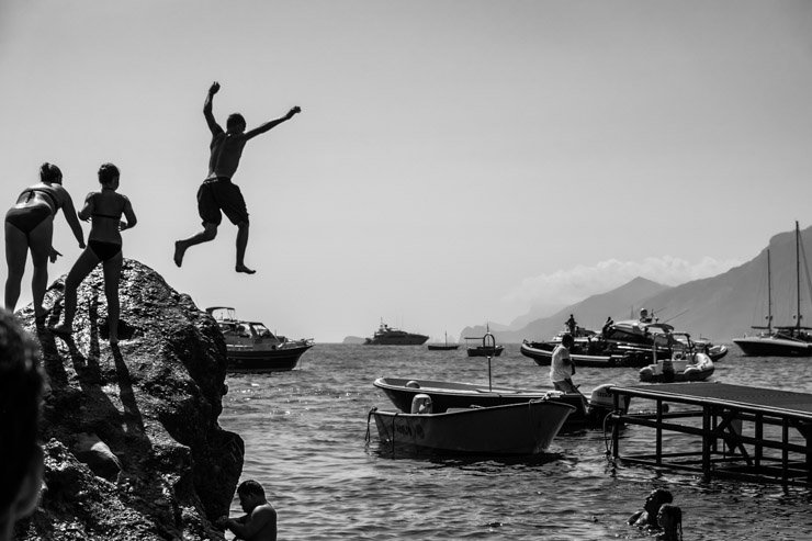 Jumping off rocks at Da Adolfo, Positano