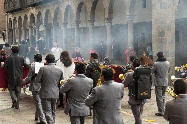 Religious procession going along Portal del Belen, Cusco, Peru