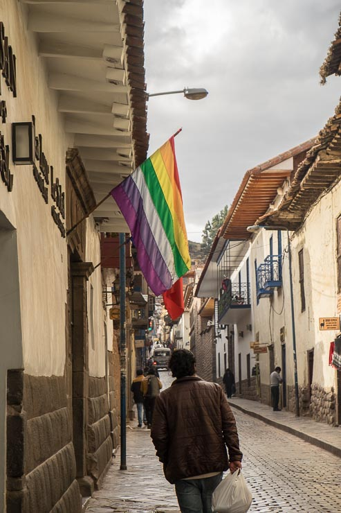 Triunfo Street, leading to the Church of San Blas, Cusco, with Cusco flag