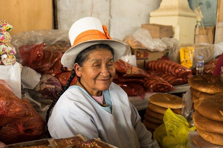 Bread seller, San Pedro market, Cusco, Peru