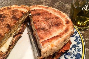 Bifana pork sandwich with yeast mayo & fennel cut in half