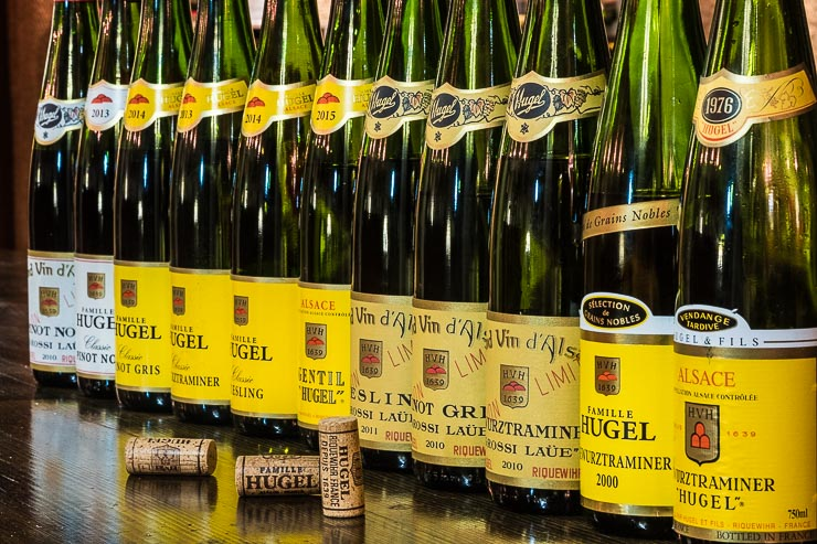 A row of bottles from Domaine Hugel, Alsace