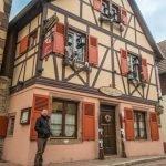 Man standing outside Le Bistro des Saveurs, Obernai, Alsace