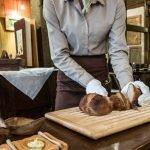 Woman cutting the bread, Le Bistro des Saveurs, Obernai, Alsace