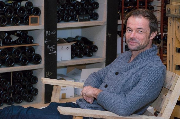 Emmanuel Brochet sitting in cellar