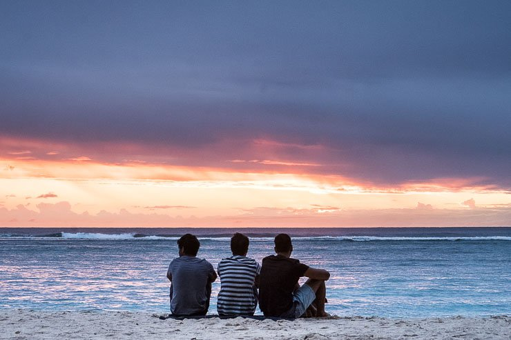 Beach, Flic-en-Flac, Mauritius, with silhouette of 3 boys
