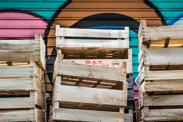 Empty crates with graffiti behind, Rue du Nil, Paris