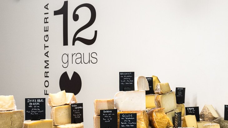 Cheese on display at 12 Graus cheese shop in Barcelona