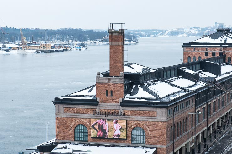 View towards Fotografiska with snow covered roof and water behind, Stockholm