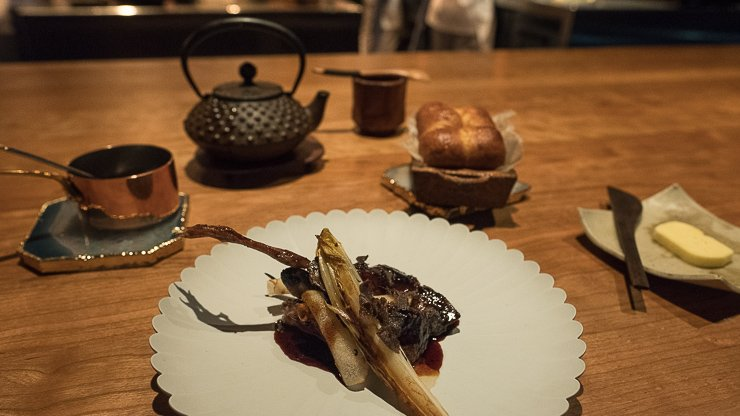 Tea of Grilled Quail & fermented mushrooms, red seaweed with silken tofu.