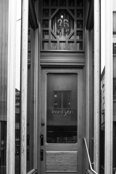 Horizontal shot of entrance door to Frantzén, on the far left, at No 26, Klara Norra kyrkogata, Stockholm