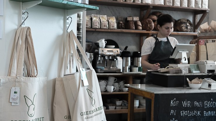 Green Rabbit tote bags with woman serving, Stockholm
