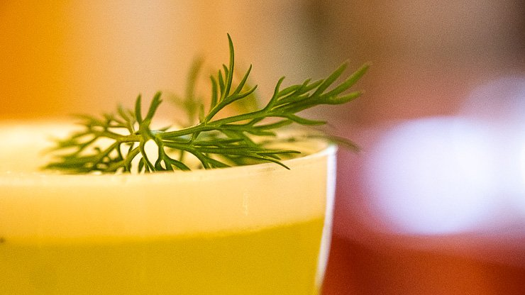 Cocktail with dill sprig at Neptune Restaurant, London