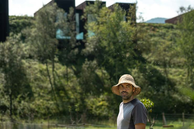 Man standing in foreground with Casa Horitzó, Les Clos, Catalonia