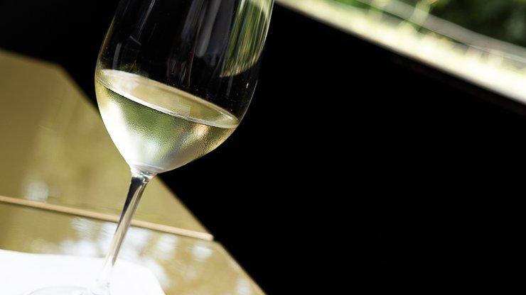 Glass of Ekam white wine, Les Cols, Catalonia