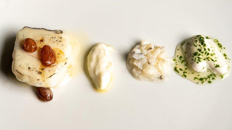 White plate with salt cod, loin, brandade, cod gut, kokotxas, Les Cols, Catalonia