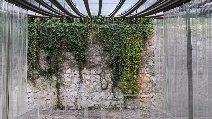 Old stone wall inside the marquee at Les Cols, Catalonia