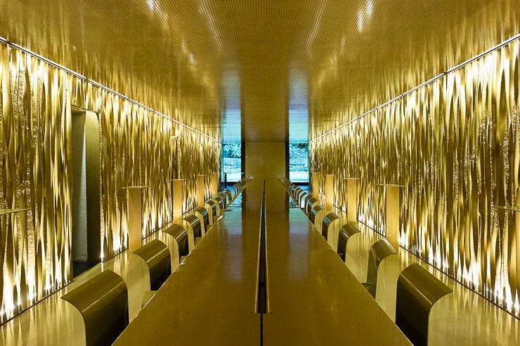 View down table of all gold, main dining room, Les Cols, Catalonia