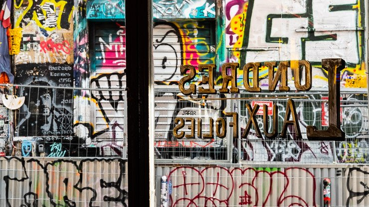 View from Aux Folies onto rue Denoyez, Paris, with graffiti on the walls