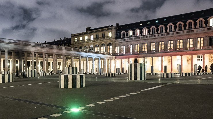 Palais-Royal at night with Daniel Buren art work and green light