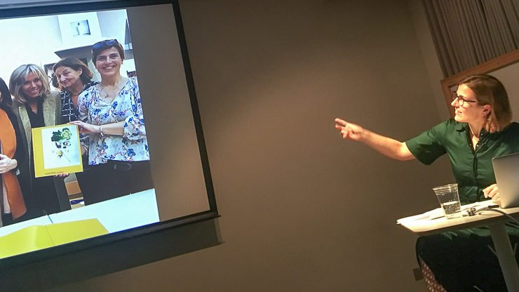 Susan Bright pointing to a projected image