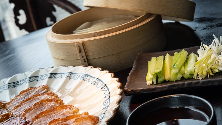 Sliced roasted Peking duck, with pancakes, spring onions, cucumber & plum sauce, Hutong