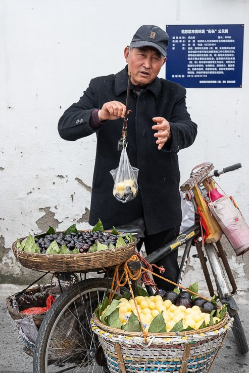 Man selling fruit from bicycle in Suzhou, China