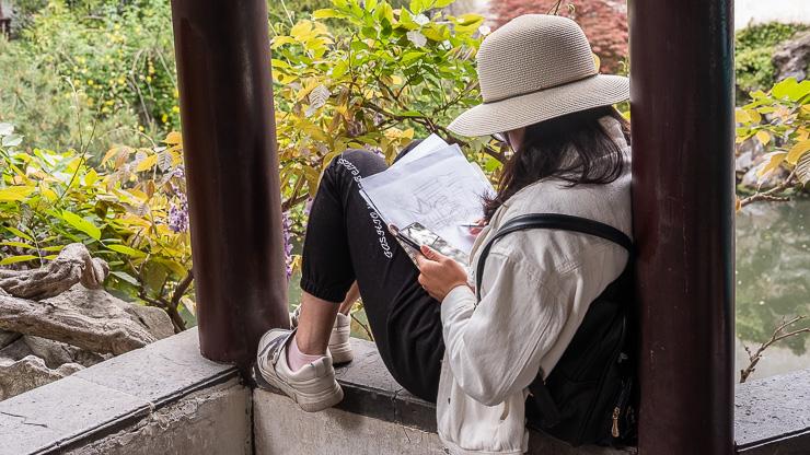 Woman sketching in Lion Grove Garden