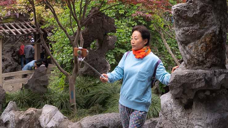 Woman taking selfie, Lion Grove Gardens, Suzhou