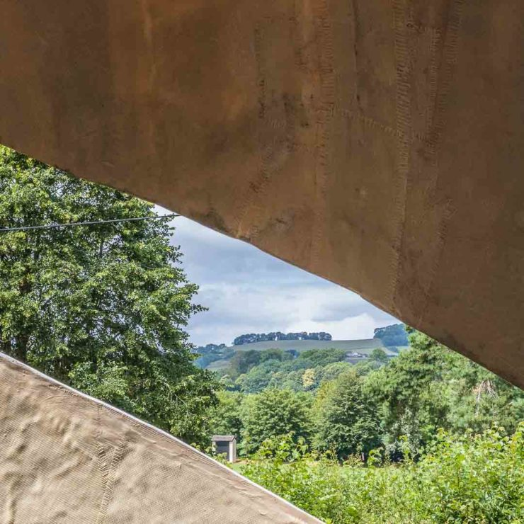 View through sculpture of trees and fields