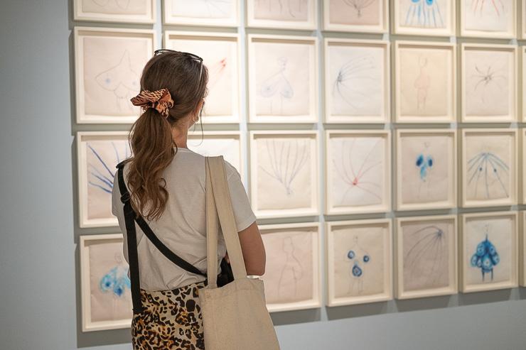 Woman looking at drawings