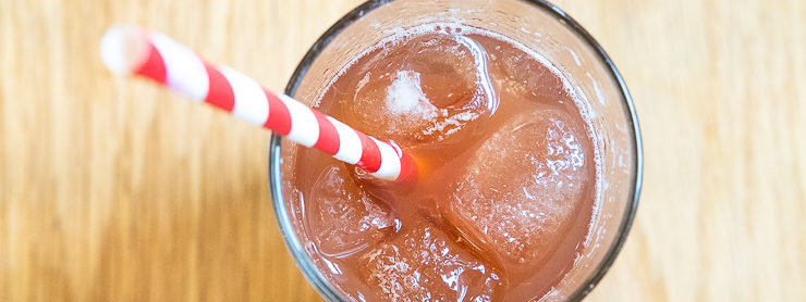 Glass with red and white paper straw