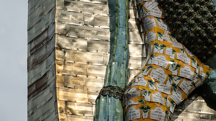 Detail of sculpture made out of date syrup tins