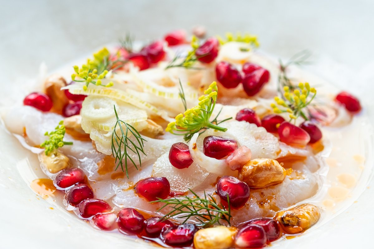 dish with pomegranates & fennel flowers